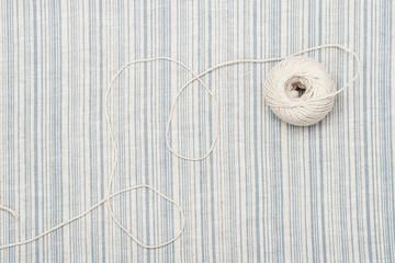 Thread Ball On Natural Linen Striped Textile