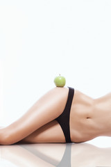 fit woman with a green apple