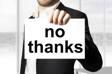businessman holding sign no thanks