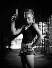 Woman in uniform with gun (monochrome version)