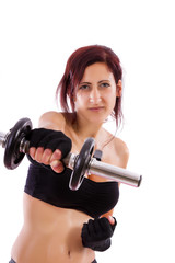 Beautiful healthy young girl with a dumbbell