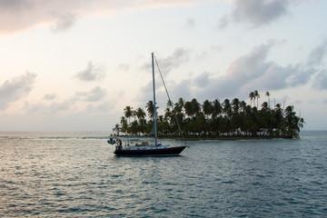 Sailing with beautiful sunset near paradise island, San Blas
