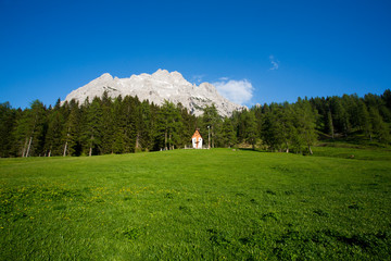 Small cute little church in the Dolomites