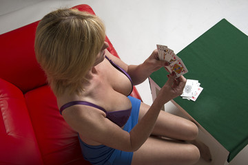 Woman playing strip poker game