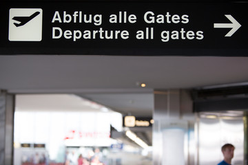 Airport white gates departure sign