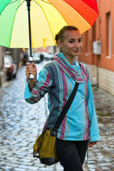 portrait of beautiful girl with a colofurl umbrella