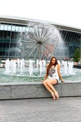 Girl near the fountain