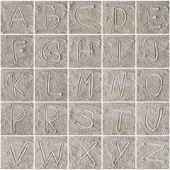 handwritten alphabet letters on flour