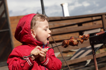 Child eating a kebab