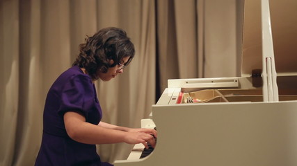Woman Play a Piano 2