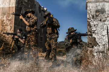 Airsoft group team in daytime action walking