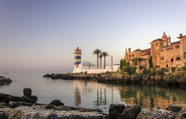 Beautiful lighthouse at dawn in soft focus