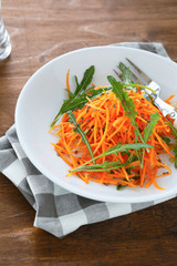 fresh salad with arugula and carrots
