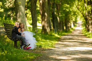 Portrait of two childrens sitting outdoors in spring park