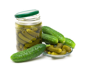 fresh and pickled cucumbers on white background
