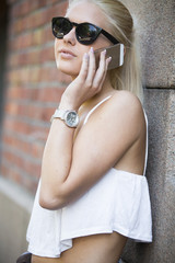Close up of casual girl talking in the phone