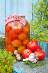 Homemade pickled tomatoes in glass jar. Fresh vegetables, dill a