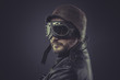 sensual, pilot dressed in vintage style leather cap and goggles