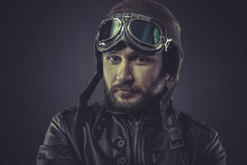 steampunk pilot dressed in vintage style leather cap and goggles