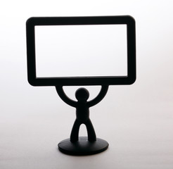 plastic figurine of a man with a placard on white background