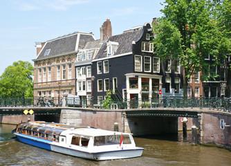 the pleasure boat under the bridge