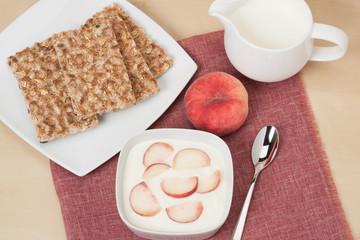 Healthy Breakfast. Fresh Peaches With Low Fat Yogurt. Crisp Brea