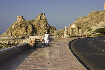 A man walking on Muscat promenade