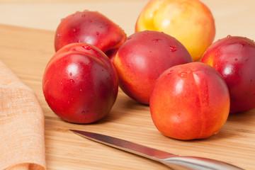Fresh Nectarine Fruits On Wooden Board. Natural Linen Napkin