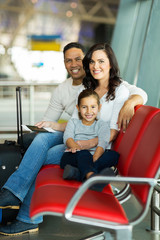 young family waiting for flight