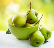 Ripe organic pears over nature green blurred background