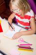 Little schoolgirl doing her lessons