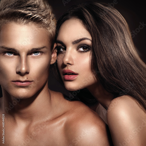 canvas print picture Sexy couple. Young man with his girlfriend posing together