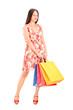 Beautiful young woman posing with shopping bags