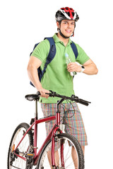 Guy with a mountain bike holding a water bottle
