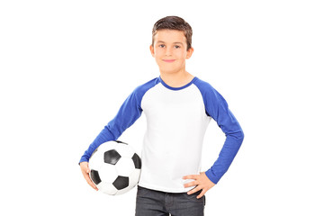 Smiling casual child holding a football