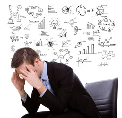 Young business man think and planning with business graph