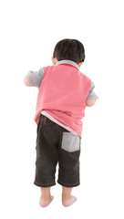 Back view of young boy looking over white background