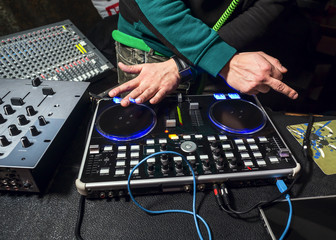 Dj playing the track and shows middle finger