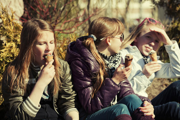 Teenage girls eating an ice cream