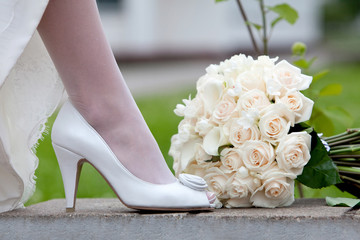 Wedding shoe and bridal bouquet close-up.