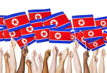 Hands Holding Flag of North Korea