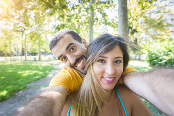 Young Couple Taking Selfie at Park