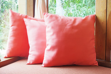 pink pillows against window view in morning