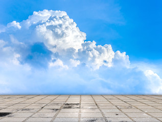 Paving tile floor with cloud and blue sky