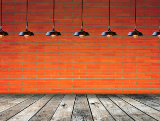 Lamp at brick wall background with ground wood