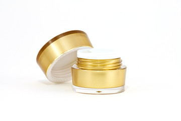 Gold cream container on white background