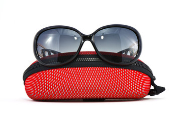 sunglasses and case on a white background