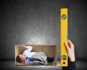 Businessman in carton box
