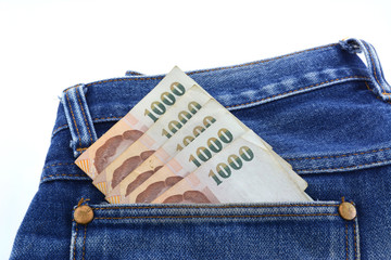 Baht in a jeans pocket.