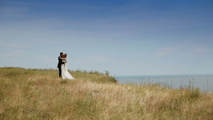 Wedding Couple Standing Against Blue Sky